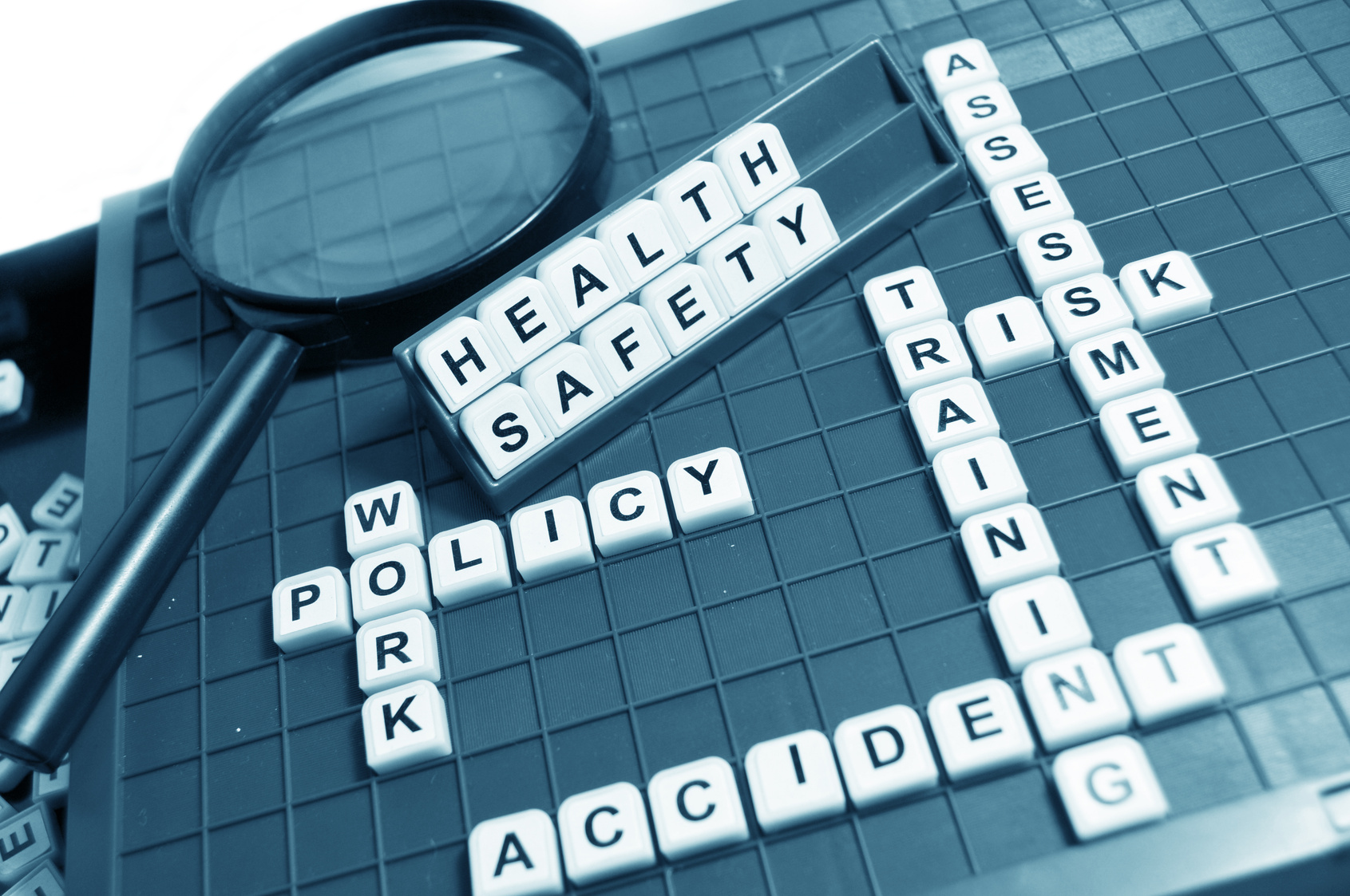 What are occupational safety and health management systems and why do companies implement them